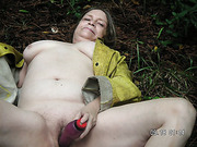 Mature wife shows off her big tits outside flashing and masturbating