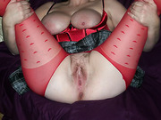 Busty wife makes her pantyhose crotchless showing her hairy pussy