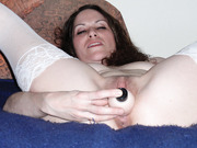 Pictures of my wife playing with a sex toy in the bedroom