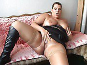 Horny bbw wife masturbates on the couch wearing black dress