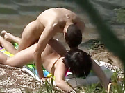 Voyeur cam sexy brunette pleases her hubby on the beach