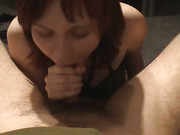 Busty redhead wife sucks on a long throbbing penis