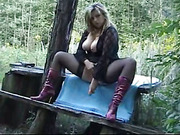 Busty milf gets dirty in the forest and gets screwed outdoors